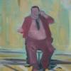 zittende man aan telefoon